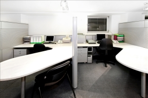 Modern office cubicles divided with folding screens